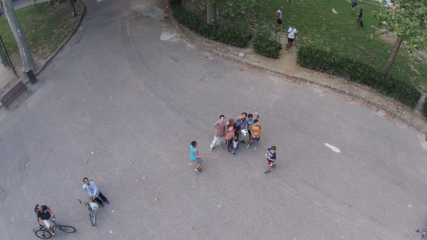 All the kids surrounding me as I flew the drone